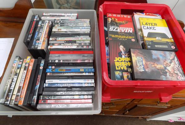 Two tubs of DVDs