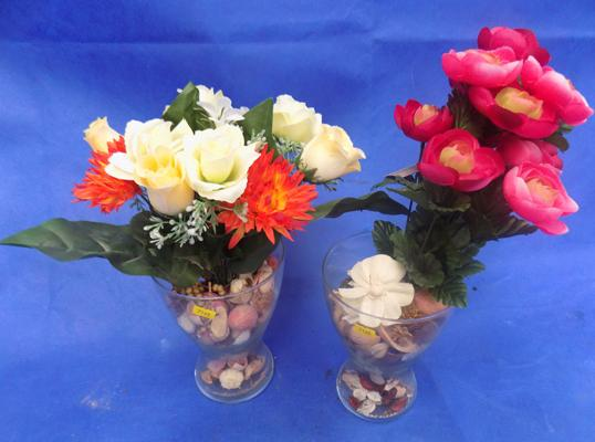 Two glass vases with flowers