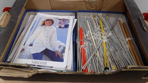 Box of knitting needles and patterns