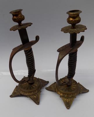 Pair of converted sword handled candlesticks