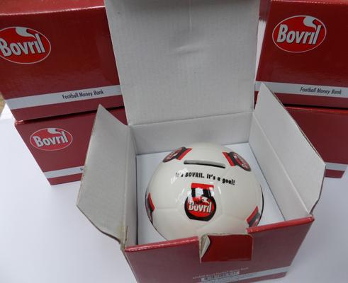 Five Bovril money boxes