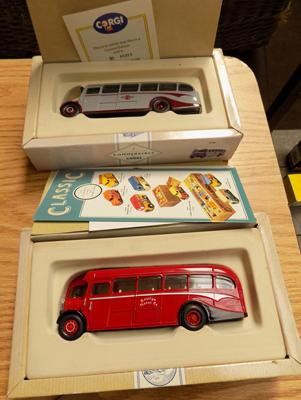 Two boxed Corgi buses