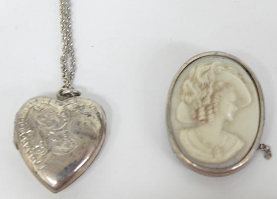 Silver cameo brooch and silver locket necklace
