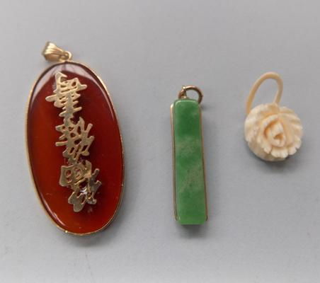 Bone and jade pendants - yellow metal