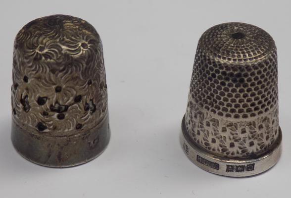 Silver thimble and one other thimble