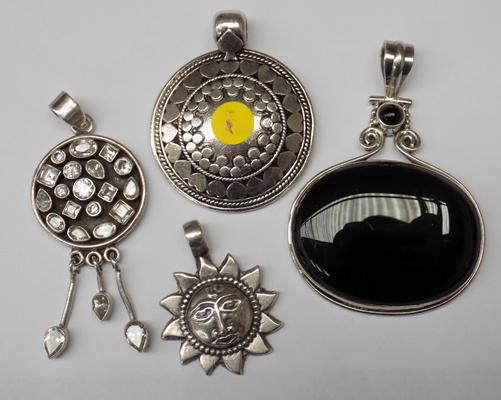 Four large 925 silver pendants
