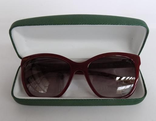 Lacoste mens deep red sunglasses in Lacoste case genuine product as new condition