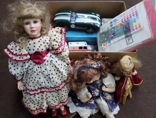 Box of vintage games and toys incl. Diecast, Hornby train set, China headed dolls and Sindy