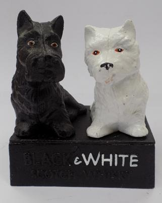 Cast iron black & white whiskey doorstop