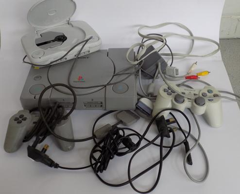 2 Sony Playstation, with attachments and controllers