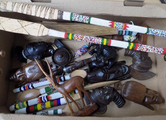 Box of ethnic wooden items and vintage face masks