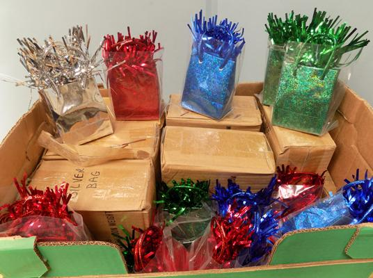 Box of gift bag balloon weights - blue, green, silver and red