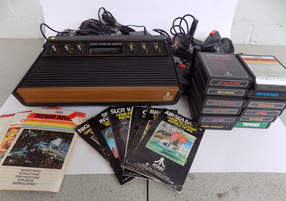 Atari 2600 (woody) all original (no box) 2 joysticks 2 paddles 12 games some instructions (space invaders) all leads in working condition