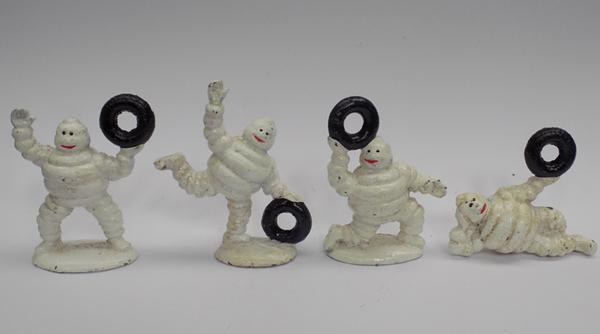 Cast iron 4 small Michelin men with tyres