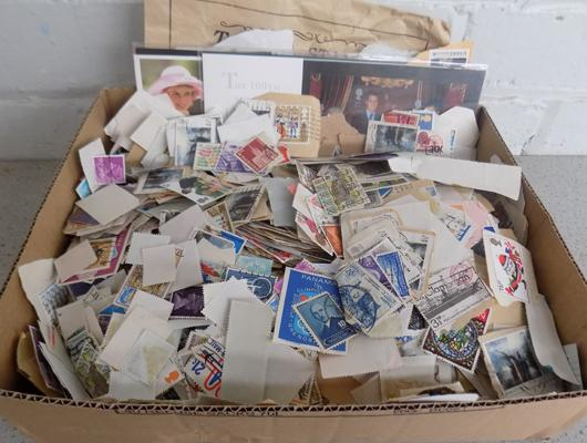 Box of used mixed stamps