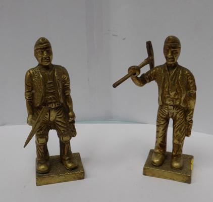 Two brass coloured miners