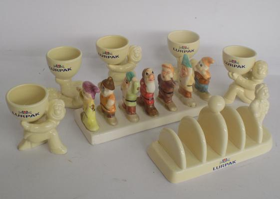 Collection of Lurpak and Clover egg cups and toast racks