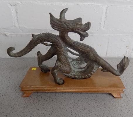Bronze Chinese dragon on wooden plinth