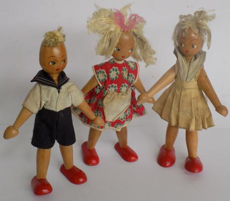 Three vintage wooden dolls C1950's