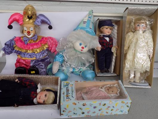 Selection of vintage porcelain dolls and clowns