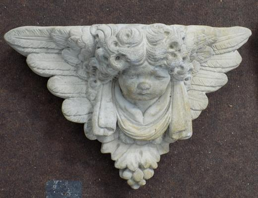 Stone Cherub's face - wall mounted plaque