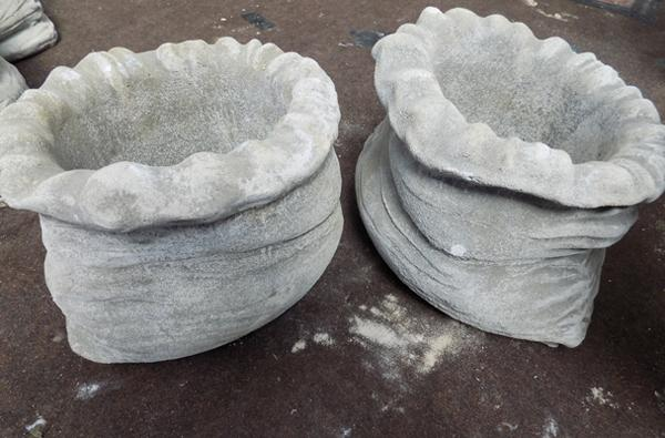 Two small sack shaped planters