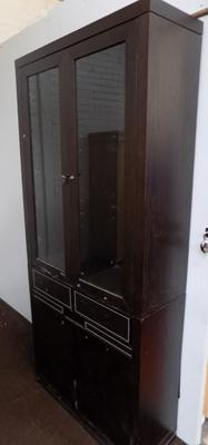 Dark wood display cabinet with leather and wood effect