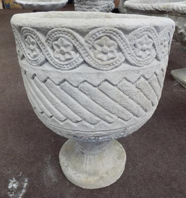 Small decorated circular urn on circular decorated base