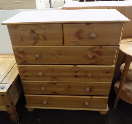 2 over 4 pine drawers-slight damage to base board & 1 drawer won't open