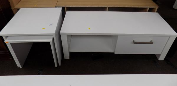 White nest of tables and entertainment unit