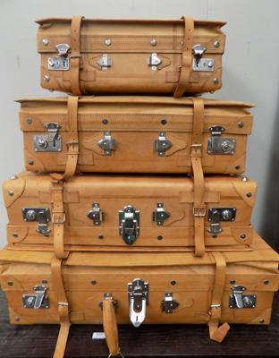 Four leather suitcases