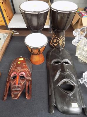 Selection of vintage wood African masks and drums