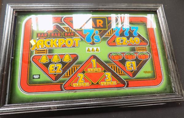 Glass framed fruit machine display - at fault