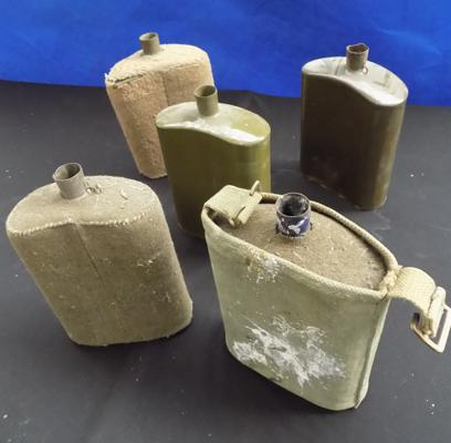 Five WWII water cannisters