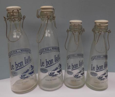 Four French milk bottles - vintage