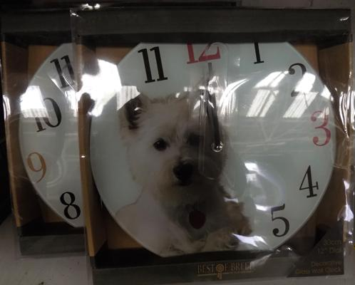 Set of four dog clocks