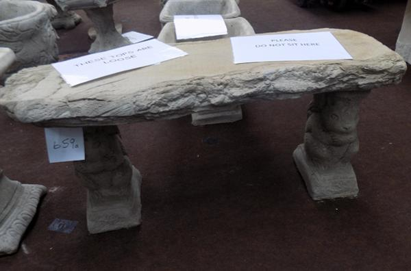 Stone timber effect seat on squirrel plinths