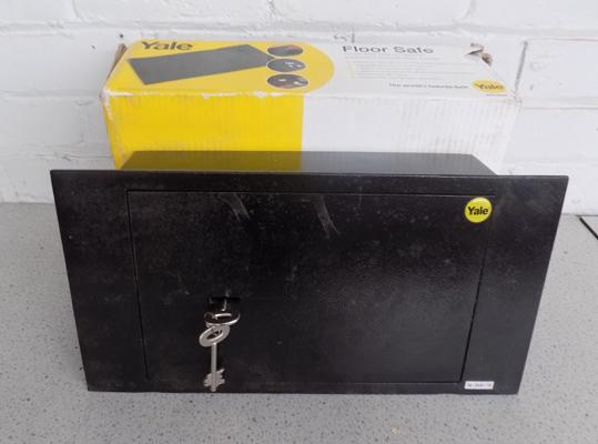 Brand new Yale floor safe in box with key (in office)