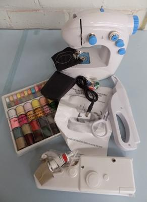 Mini sewing machine in box