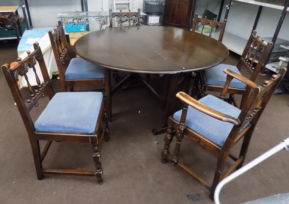 Six old colonial dark elm chairs - Ercol, & Ercol drop leaf space saver dining table