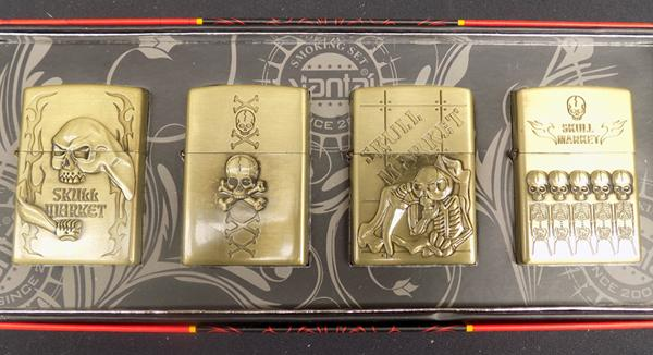 Four oil lighters with skull design