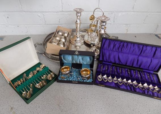 Silver plate items on tray, candlesticks, spoons, salts, egg cup stand etc...
