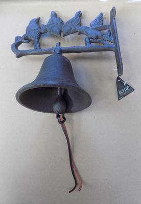 Cast iron bell with bird design