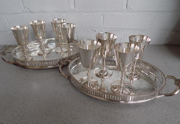 Two silver plated trays & eight goblets