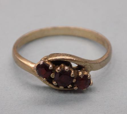Gold on silver ring with garnet stones