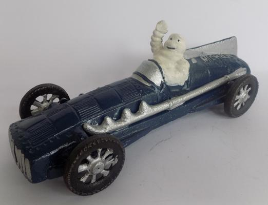 Cast iron Michelin man in blue racing car