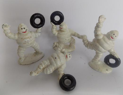 Four cast iron Michelin Men with tyres