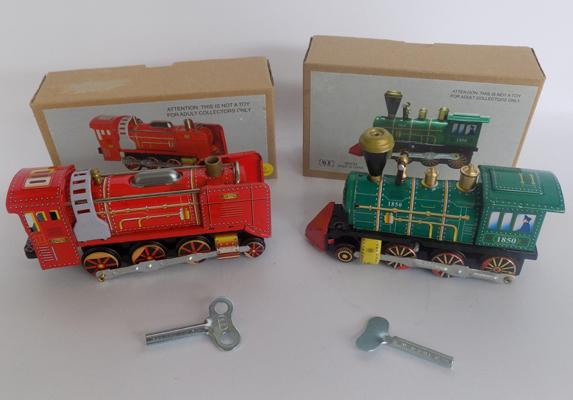Two tin plate wind up trains