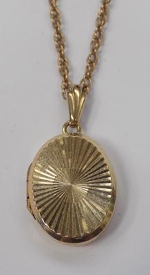 "9ct gold oval locket on 20"" gold chain"