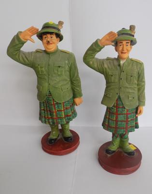 Laurel & Hardy figures in kilts